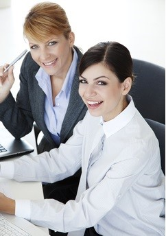 Businesswomen Using PMP Exam Simulator to Pass PMP Exam